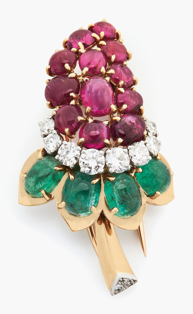 Cartier ruby, emerald and diamond flower brooch. Estimate $3,000-5,000. This lot is offered in Christie's Jewels Online on 14-22 June 2017