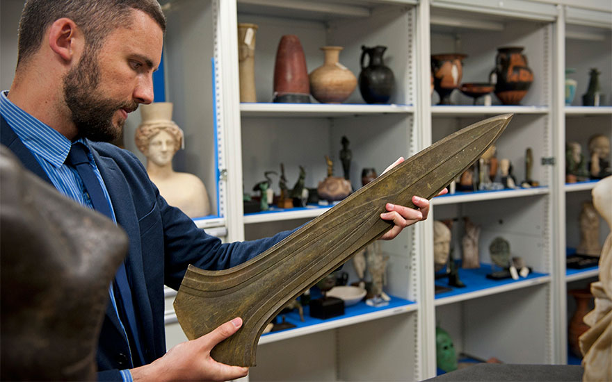 Specialist Claudio Corsi examines the finely crafted Bronze Age dirk