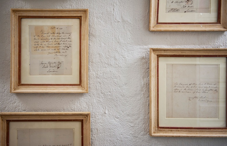 Framed correspondence from James Christie lines the walls of the archives