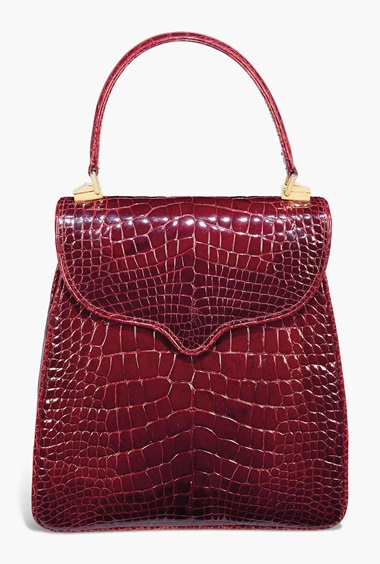 A burgundy alligator Princess Diana handbag. By Lana Marks, 1995. 9 x 9½ in (22 x 24 cm). Estimate £4,000-6,000. This lot is offered in The Collection of Raine, Countess Spencer  on 13 July 2017 at Christie's in London, King Street