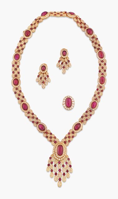 An 18 carat gold, ruby and diamond parure by Van Cleef & Arpels. Estimate £100,000-150,000. This lot is offered in The Collection of Raine, Countess Spencer on 13 July 2017 at Christie's in London, King Street