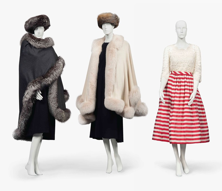 Four fox fur-trimmed cashmere wraps (two shown). By Zwirn, two by Denis Basso and one unlabelled. Estimate £800-1,200. A dinner dress. Probably by Pierre Balmain, unlabelled. Estimate £1,000-1,500. These lots are offered in The Collection of Raine, Countess Spencer  on 13 July 2017 at Christie's in London, King Street