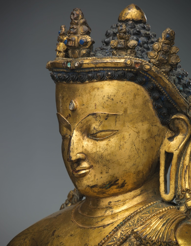 In this gilt Buddha, the influence of Pala art — an important sculptural style that reached its peak in Northeast India in the 12th century — can be seen in the profile, particularly the long, protruding nose