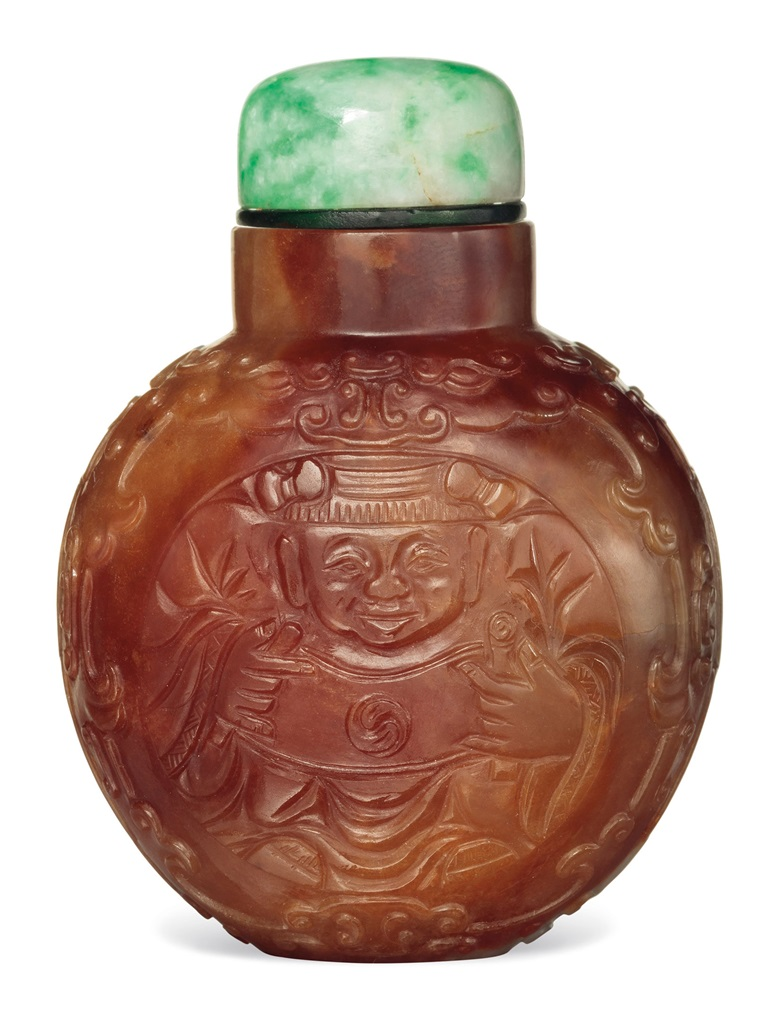 A carved two-colour jadeite snuff bottle. 1780-1840. 2 in (5.1 cm) high. Estimate $12,000-18,000. This lot is offered in The Ruth and Carl Barron Collection of Fine Chinese Snuff Bottles Part V on 13 September 2017 at Christie's in New York
