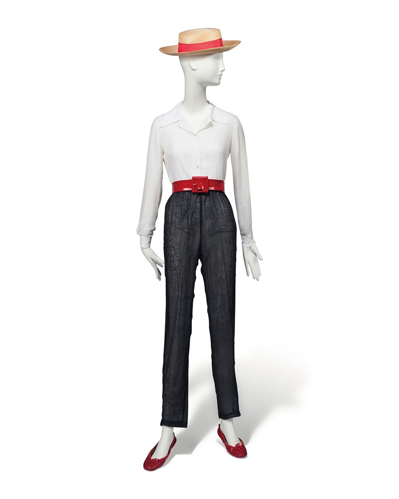 A crisp white linen shirt and black linen trousers, Basile and marisa padouan, 1980s, the open necked shirt with long sleeves, the trousers loosely cut, tapering to the ankle; together with gondoliers hat, red ballet pumps, possibly by capezio and a lipstick red belt; the hat with paper label il cappello di paglia, 0614, Yenezia, 31 Agosto 1983, with a red silk hat band. Estimate £3,000-5,000.