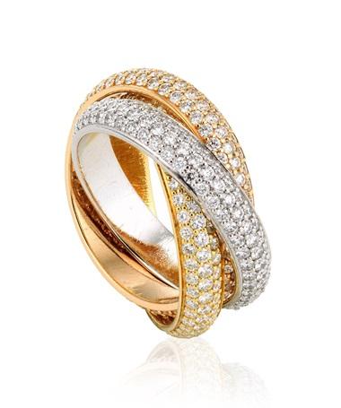 Cartier Trinity diamond ring. Composed of three tri-coloured interlocking bands, each pavé-set with three rows of round diamonds