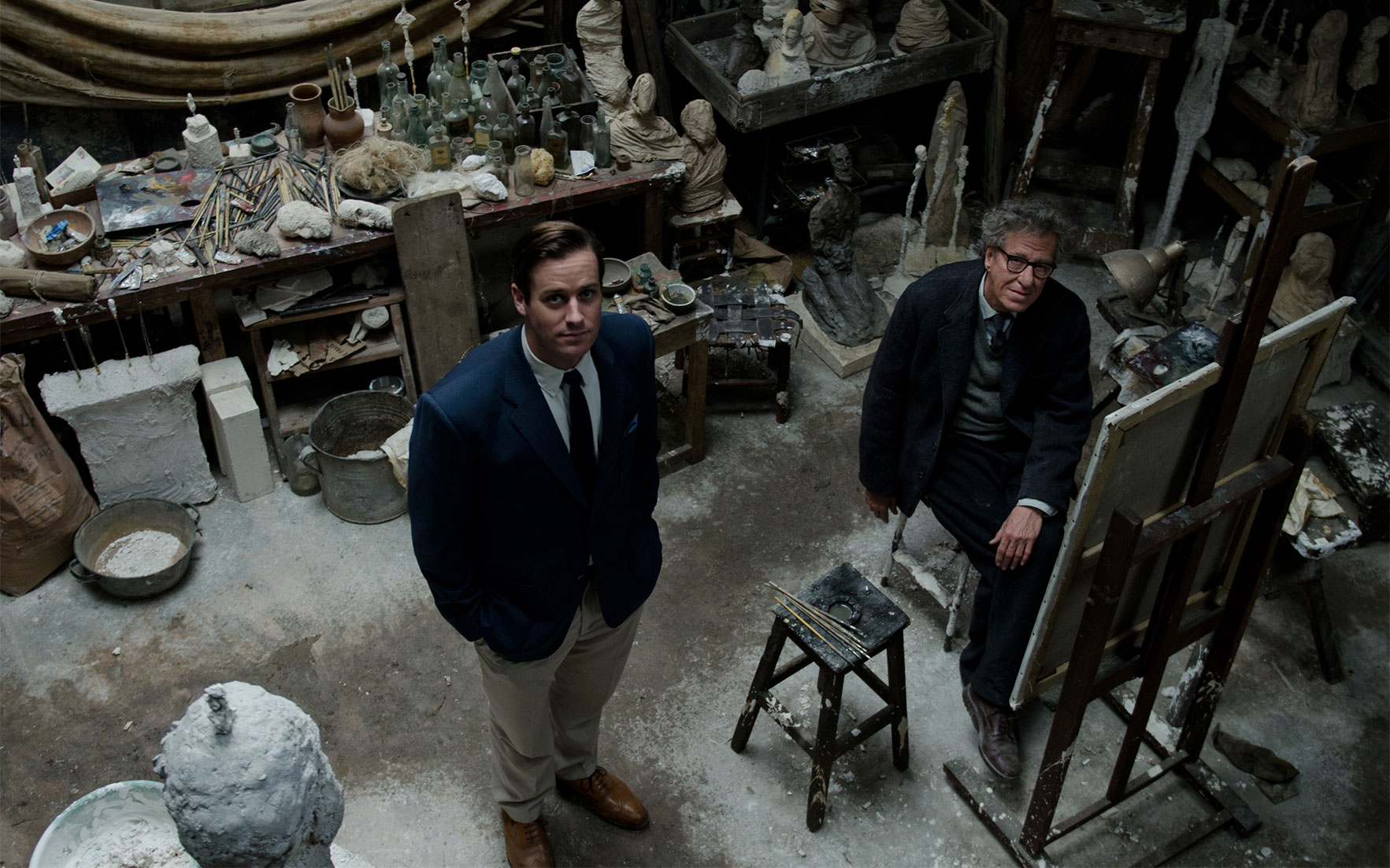 Main image James Lord (Arnie Hammer) and Alberto Giacometti (Geoffrey Rush) in the artist's Paris studio, recreated in London by production designer James Merifield. Credit Parisa