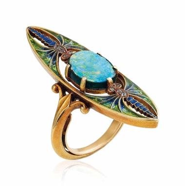 An Art Nouveau doublet opal, enamel and diamond ring, by Eugène Feuillâtre, circa 1900. This lot was offered in Beyond Boundaries Magnificent Jewels from a European Collection on 13 November 2017 at Christie's in Geneva and sold for CHF 27,500