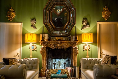 The Green Sitting Room at Casa Fornasetti in Milan, and detail of guest room with marine theme. Photos courtesy Fornasetti