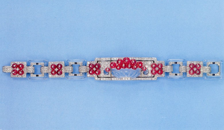 An exquisite Art Deco ruby, diamond, rock crystal and black enamel bracelet, by Cartier, circa 1925. Sold in our Jewellery by Cartier sale on 21 May 1992 at Christie's in Geneva