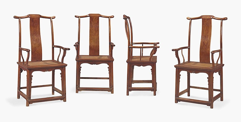An important and very rare set of four huanghuali Four-corners-exposed Officials Hat armchairs, sichutouguanmaoyi, late 16th to early 17th century. 48  in (122  cm) high, 23¼  in (59  cm) wide, 18⅝  in (47.4  cm) deep. Sold for $4,197,000 on 17-18 September 2015  at Christie's in New York