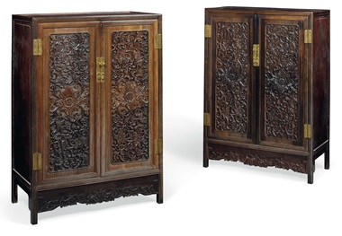 A pair of finely carved Zitan and hardwood cabinets, 19th century. Each 47¼  in (119.5  cm) high, 32¾  in (82.5  cm) wide, 14¾  in (37.5  cm) deep. Estimate £40,000-80,000. This lot is offered in Fine Chinese Ceramics & Works of Art on 7 November at Christie's in London