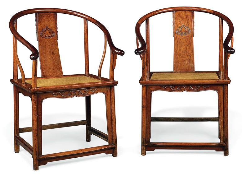 A rare pair of Huanghuali horseshoe-back armchairs, Quanyi, 17th-18th century. Each 26½  in (67.3  cm) wide, 19¼  in (49  cm) deep, 38¾  in (98.5  cm) high. Estimate £200,000-400,000. This lot is offered in Fine Chinese Ceramics & Works of Art on 7 November at Christie's in London