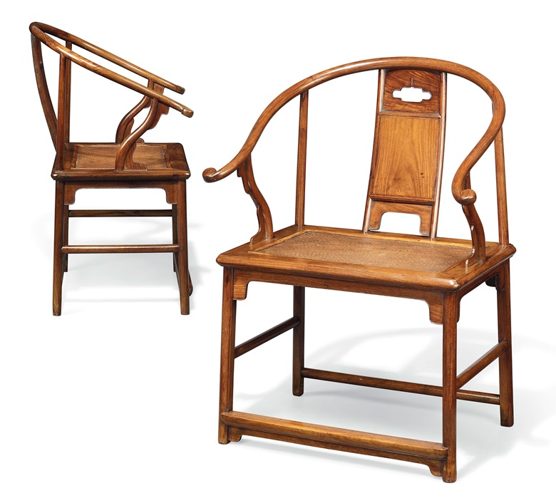 An extremely rare and important pair of Huanghuali horseshoe-back armchairs, Quanyi, Ming dynasty, 17th century. Each 26¾  in (68  cm) wide, 21  in (53.3  cm) deep, 36  in (91.5  cm) high. Estimate £800,000-1,200,000. This lot is offered in Fine Chinese Ceramics & Works of Art on 7 November at Christie's in London