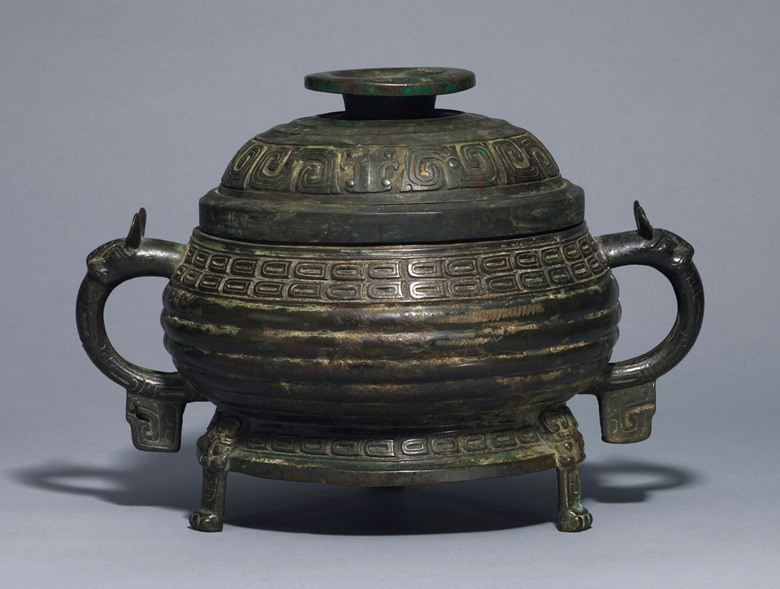 A bronze ritual tripod food vessel and a cover, gui, Western Zhou dynasty (1100-771 BC). 13¾ in (34.9 cm) wide. Estimate £50,000-80,000. This lot is offered in Fine Chinese Ceramics & Works of Art on 7 November 2017  at Christie's in London