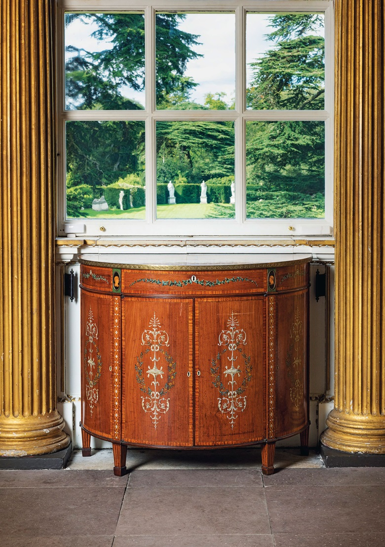 A George III lacquered brass-mounted padouk and polychrome-decorated demi-lune commode, circa 1775. 35¼  in (90 cm) high; 40½ in (103 cm) wide; 18¼ in (46.5 cm) deep. Estimate £20,000-30,000. This lot is offered in The Collector English Furniture, Clocks & Works of Art on 15 November 2017  at Christie's in London