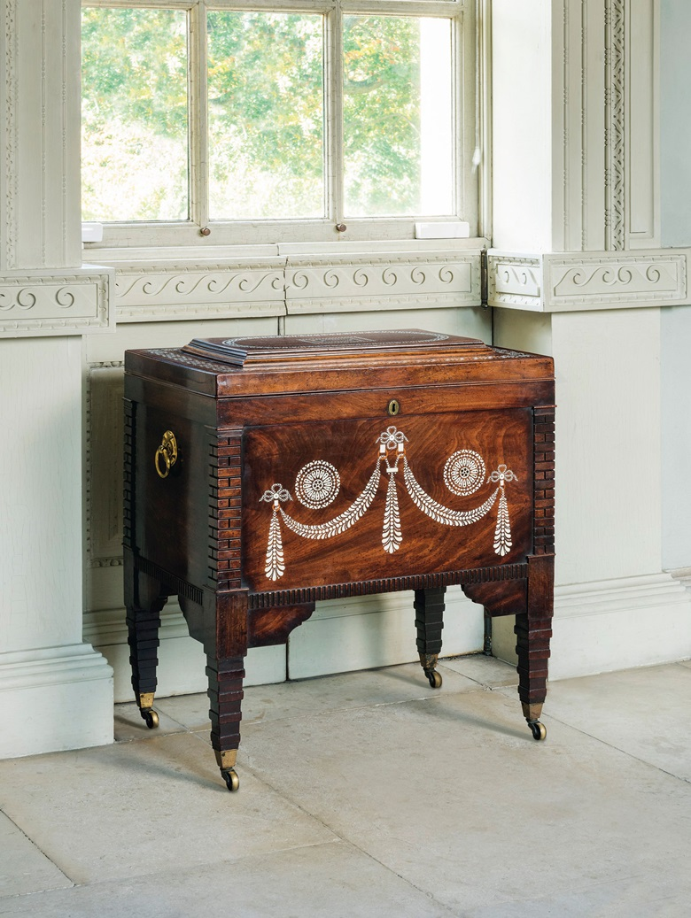 A George III mahogany, bone and amaranth-inlaid cellaret, circa 1800. 22¼  in (56.5  cm) high; 28½  in (72.5  cm) wide; 19½  in (49.5  cm) deep. Estimate £7,000-10,000. This lot is offered in The Collector English Furniture, Clocks & Works of Art on 15 November 2017  at Christie's in London