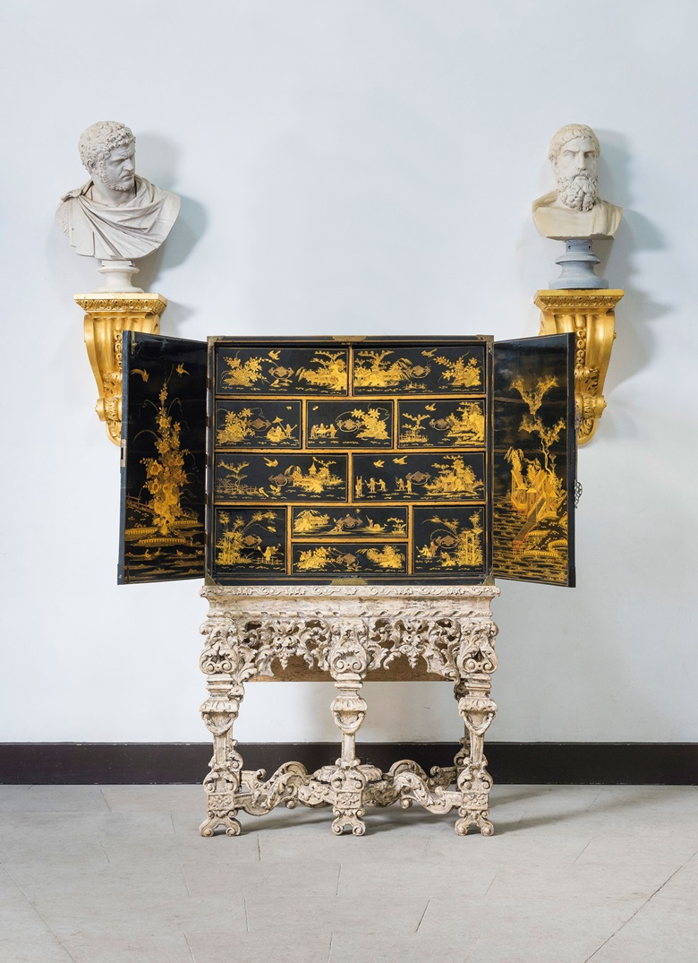 A William and Mary brass-mounted black and gilt japanned cabinet-on-stand, circa 1700, the stand in the manner of Gerrit Jensen. 68¼  in (173  cm) high; 41¼  in (105  cm) wide; 20  in (51  cm) deep. Estimate £10,000-15,000. This lot is offered in The Collector English Furniture, Clocks & Works of Art on 15 November 2017  at Christie's in London