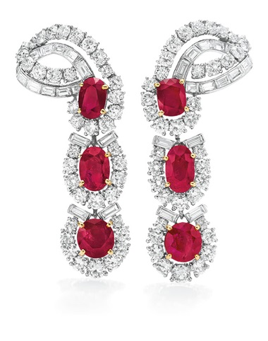 A Pair of ruby and diamond ear pendants, by Cartier. Sold for $782,500 in The Collection of Elizabeth Taylor The Legendary Jewels, Evening Sale on 13 December 2011  at Christie's in New York