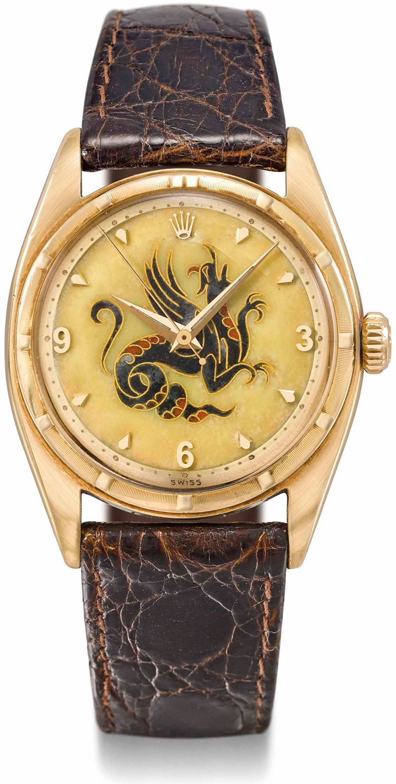 Rolex. A highly important and exceptionally rare 18k gold automatic wristwatch with sweep centre seconds and cloisonné enamel dial depicting a dragon by Nelly Richard. Signed Rolex, Perpetual Chronometer. Ref. 6099, Movement no. 53814, Case no. possibly 8528, circa 1952. Sold for CHF 125,000 in Rare Watches on 13 November 2017  at Christie's in Geneva