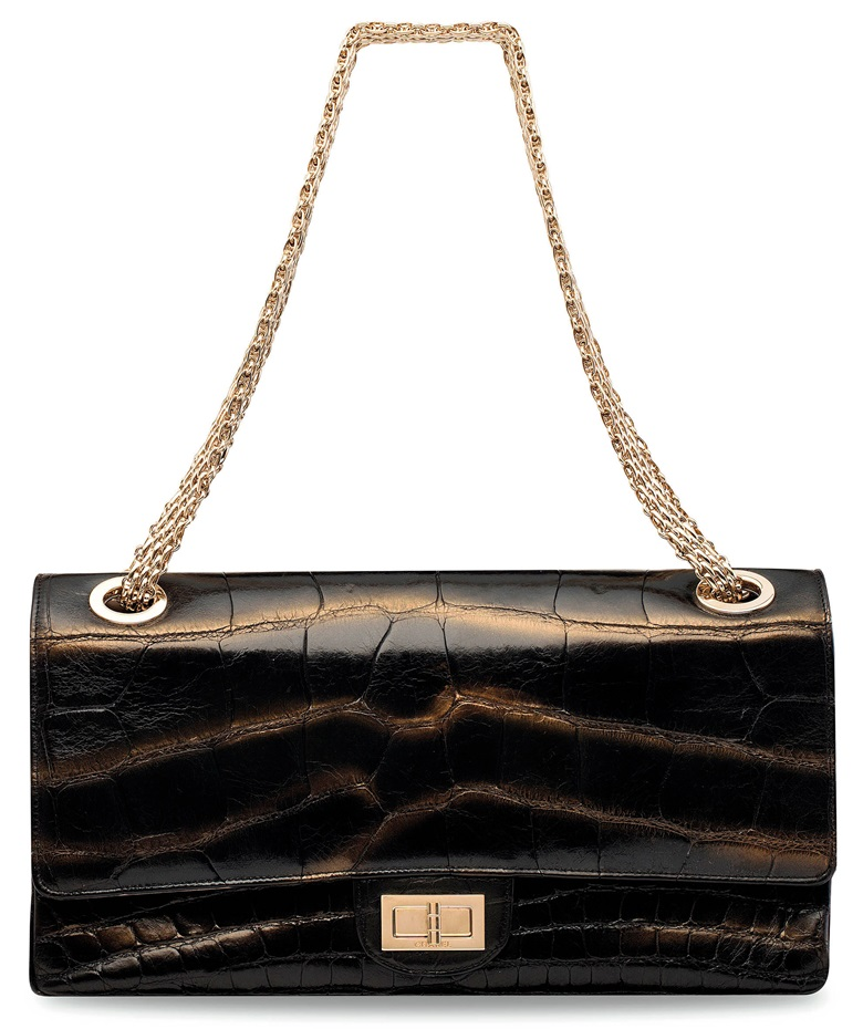 A limited-edition Mobile Art HK by Karl Lagerfeld,  Chanel, 2008. Shiny black & gold metallic alligator 2.55 double flap 228 bag with gold hardware. Sold for HK$100,000 on 31 May 2017  at Christie's in Hong Kong