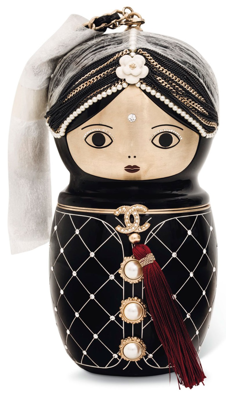 A Paris Bombay limited edition black plexiglas Matryoshka evening bag with silver hardware. Chanel, Métiers d'Art pre-AutumnWinter 2012–13. Estimate €4,000–6,000. This lot is offered in Sacs & Accessoires on 12 December at Christies in Paris