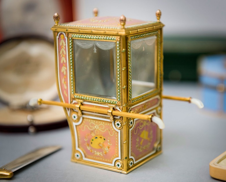 An exceptional and rare guilloché enamel and varicolour gold miniature model of a sedan chair, marked Fabergé. 3½  in (9  cm) high. Estimate £700,000-1,000,000. This lot is offered in Important Russian Art on 27 November 2017  at Christie's in London
