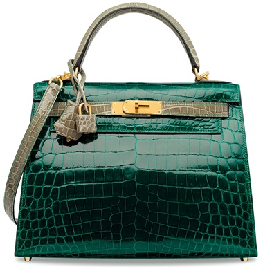 A Custom Shiny Vert Émeraude & Gris Tourterelle Niloticus Crocodile Sellier Kelly 28 With Brushed Gold Hardware. 28 w x 20 h x 11 d cm. Estimate HK$600,000-700,000. This lot is offered in Handbags & Accessories  on 29 November 2017  at Christie's in Hong Kong  This special order, two-tone Kelly adds an air of royalty to an ensemble. This night-time beauty rivals neutral bags