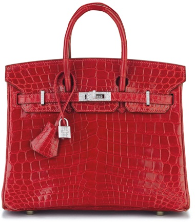 An exceptional, shiny braise niloticus crocodile diamond birkin 25 with 18k white gold & diamond hardware, Hermès, 2005. 25 w x 19 h x 13 d cm. Estimate $70,000-90,000. This lot is offered in Handbags & Accessories, 22 November to 5 December 2017, Online  This dazzling braise red mini Birkin is a statement piece for any special occasion.       .captiondesc { font-family LyonRegular, Arial,