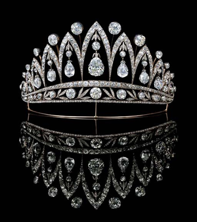 A magnificent antique diamond tiara, by Fabergé. Designed as a series of graduated old-cut diamond arches with knife-edge collet spacers, the central pear-shaped diamond flanked by three briolette and one old-cut diamond, each with diamond collet and leaf surmount to the foliate band, on gold wire frame, mounted in silver and gold, circa 1890, 13.2 cm wide, with Russian assay marks for