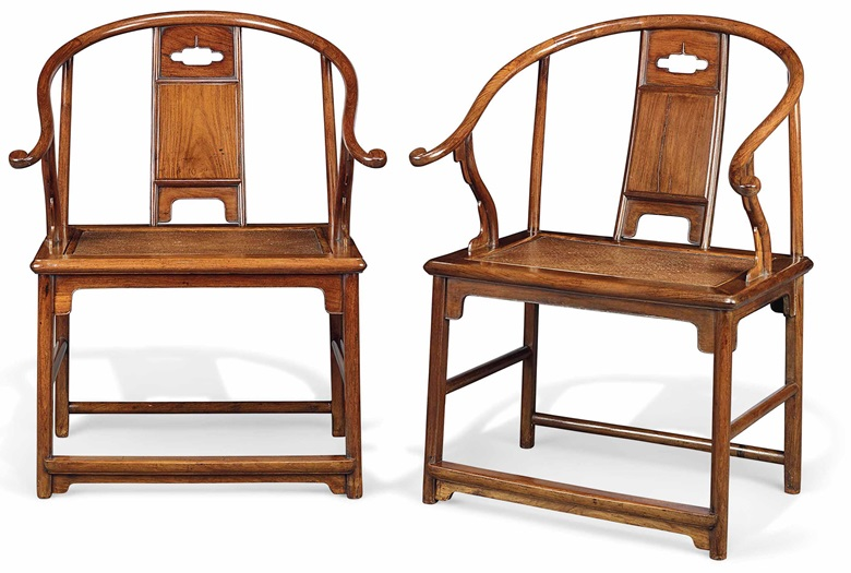 An extremely rare and important pair of huanghuali horseshoe-back armchairs, quanyi, Ming dynasty, 17th century. Each 26¾  in (68  cm) wide, 21  in (53.3  cm) deep, 36  in (91.5  cm) high. Sold for £908,750 on 7 November 2017  at Christie's in London
