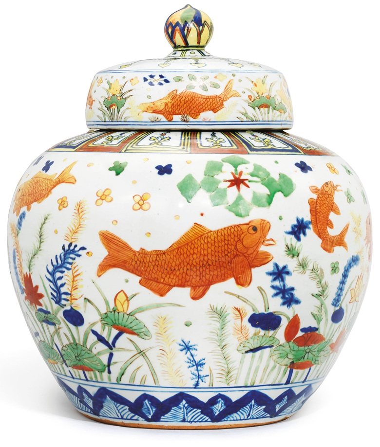 A highly important and extremely rare wucai 'fish' jar and cover, Jiajing six-character mark in underglaze blue and of the period (1522-1566). 18⅛  in (46  cm), brocade box. This lot was offered in Important Ming Imperial Works of Art from The Le Cong Tang Collection Evening Sale on 27 November 2017  at Christie's in Hong Kong and sold for HKD 213,850,000