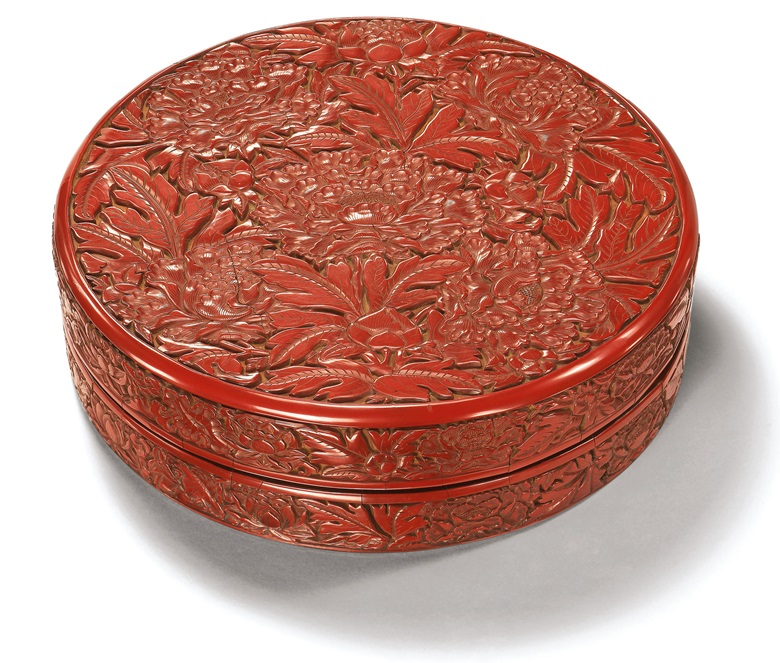 A superbly carved cinnabar lacquer box and cover, Yongle incised six-character mark and of the period (1402-1425). 10½ in (26.5 cm) diam, Japanese wood box. This lot was offered in Important Ming Imperial Works of Art from The Le Cong Tang Collection Evening Sale on 27 November 2017  at Christie's in Hong Kong and sold for HKD 8,740,000