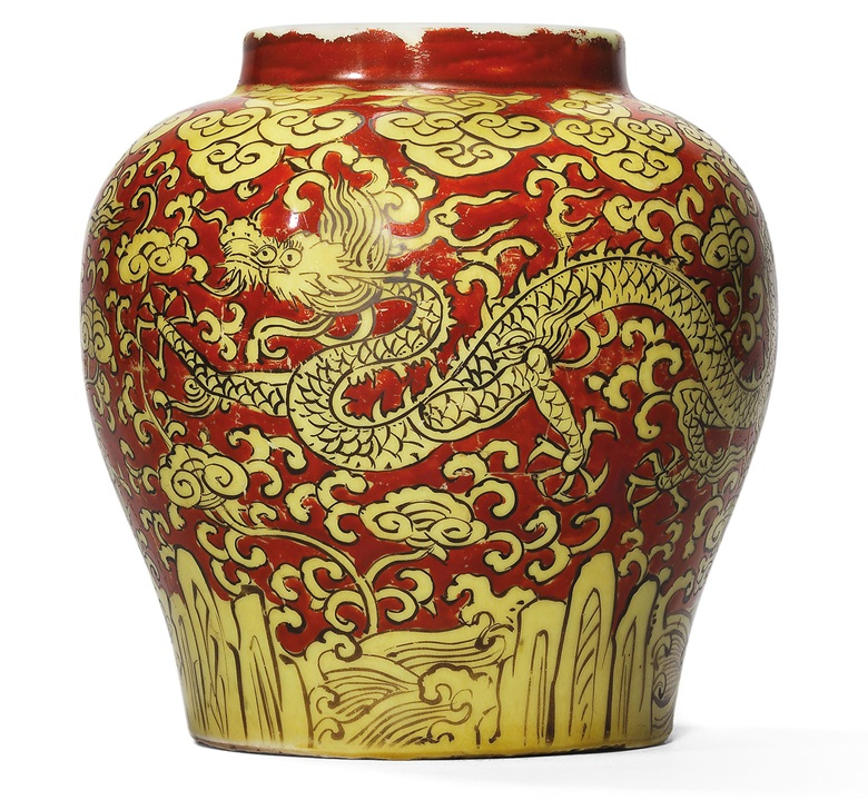 An exceptional and rare red and yellow-enamelled 'dragon' jar, Jiajing six-character mark in underglaze blue and of the period (1522-1566). 5¾  in (13.7  cm) high, Japanese wood box. Sold for HK$1,284,100 on 28 October 2002 at Christie's in Hong Kong