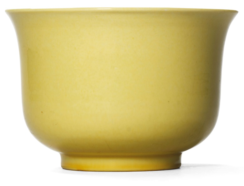 A fine and extremely rare yellow-enamelled bowl, Xuande incised six-character mark within a double circle and of the period (1426-1435). 6  in (15.2  cm)  diam. Sold for HK$1,670,000 on 25 October 1993 at Christie's in Hong Kong