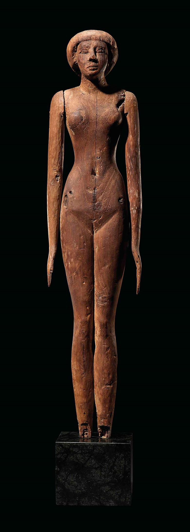 A large Egyptian wood female figure, circa                          2500-2055 BC. 28 in (71 cm) high. Estimate                          £250,000-350,000. This lot is offered in                          Antiquities on 6 December 2017 at Christie's in                          London