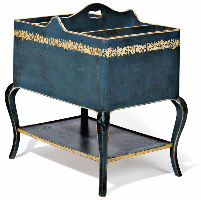 A Louis XV-style blue and cream-painted magazine caddy, attributed to Syrie Maugham, first half 20th century. 25  in (63.5  cm) high, 23  in (58.5  cm) wide, 16¼  in (41.5  cm) deep. Estimate $1,000-1,500. This lot is offered in Interiors on 12-13 December 2017  at Christie's in New York