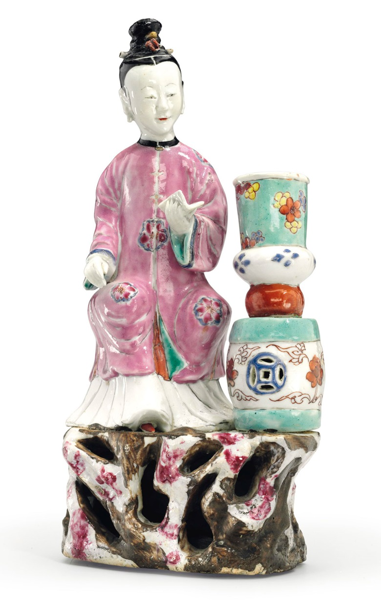 A small famille rose court lady candleholder, Qianlong period (1736-1795). 9 in (22.8  cm) high. Estimate $6,000-9,000. This lot is offered in Chinese Export Art Featuring 100 lots from Marchant, est 1925 on 18 January 2018  at Christie's in New York
