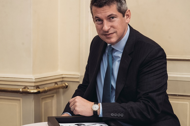 Christie's Head of Watches John Reardon with Joe DiMaggio's Patek Philippe Ref. 130. Photograph by Alex Stephen Teuscher