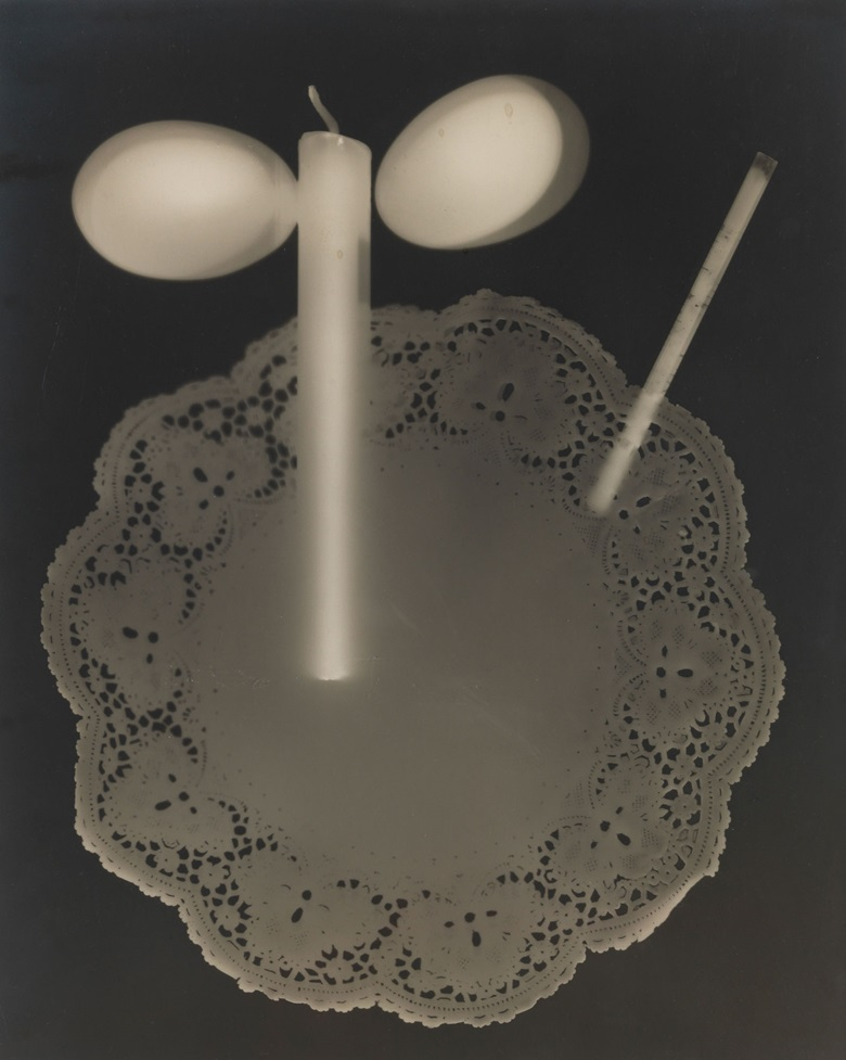 Man Ray (1890-1976), Rayograph, 1923. Unique gelatin silver print, mounted on card. Imagesheet 11¾ x 9½ in (29.9 x 24.1 cm). Mount 14¾ x 11 in (37.4 x 27.9 cm). Estimate $200,000-300,000. This work is offered in the Photographs Day Sale on 10 October at Christie's in New York