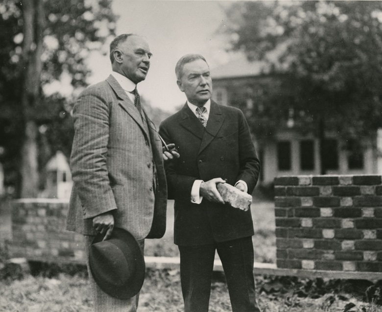 Dr. W.A.R. Goodwin, left, and John D. Rockefeller, Jr., discussing plans for the Williamsburg restoration, 1928. Photo The Colonial Williamsburg Foundation. Courtesy of the Rockefeller Archive Center