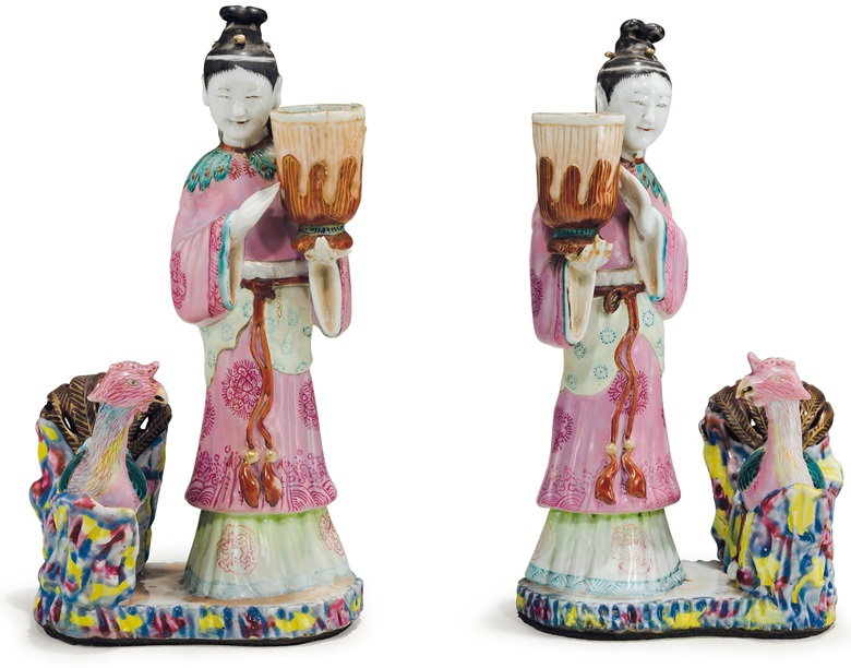 A pair of Chinese export famille rose court lady candleholders, Qianlong period (1736-95). 8½  in (21.6  cm) high. Estimate $10,000-15,000. This lot is offered in The Collection of David and Peggy Rockefeller English & European Furniture, Ceramics & Decorations, Part I on 9 May at Christie's in New York