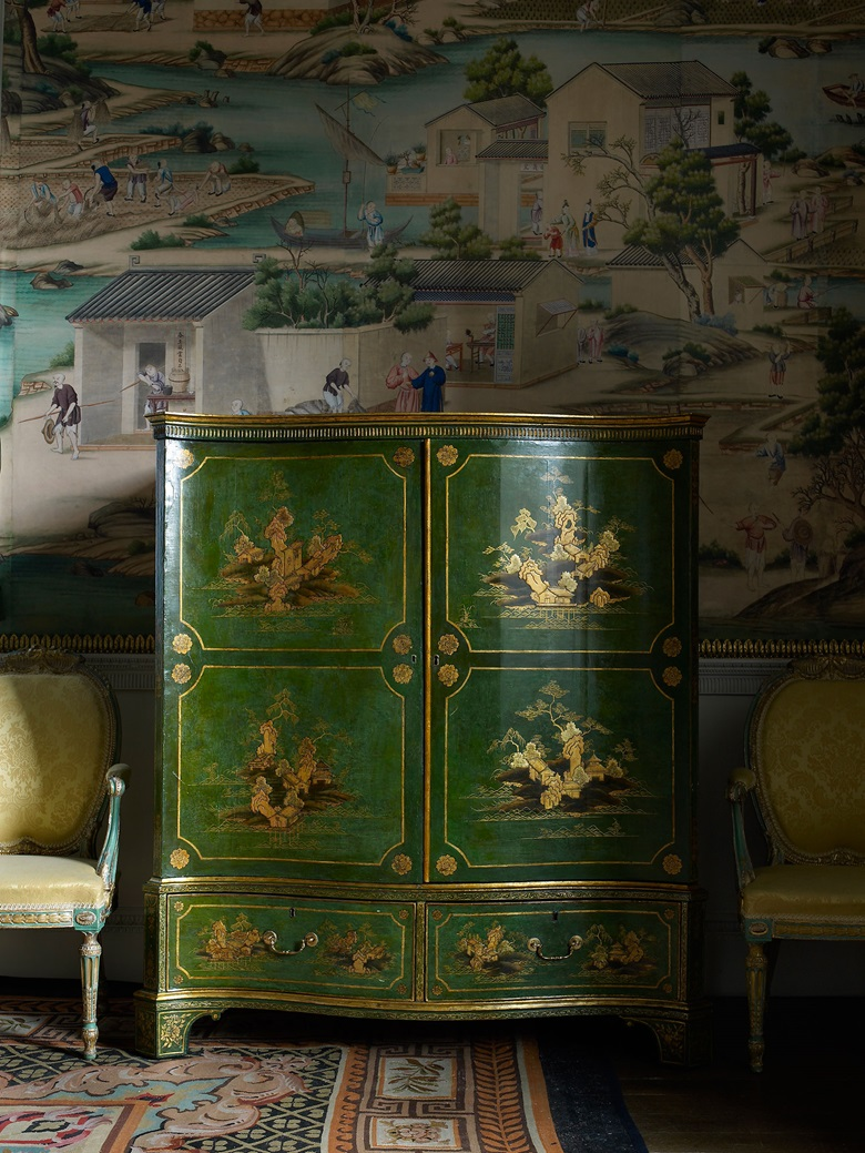 A green and gold jappaned (painted) clothes press designed by Thomas Chippendale Senior in the Chinese style, circa 1769-1770. This piece is part of a suite of furniture made to accompany the Chinese wallpaper now hanging in the East Bedroom at Harewood House. © Harewood House Trust. Photograph by Paul Barker