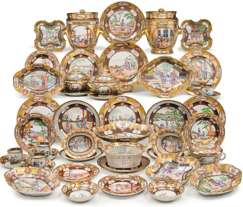 The Rockefeller Service, Jiaqing Period, circa 1805. Each piece brightly enamelled in famille rose colours with a different, finely detailed Chinese figure scene set in garden or landscape, the large scenes contained within inner borders of sepia diaper pattern and outer borders of richly gilt scrollwork, both borders inset with cartouches in sepia and iron-red. Estimate $100,000-150,000. This