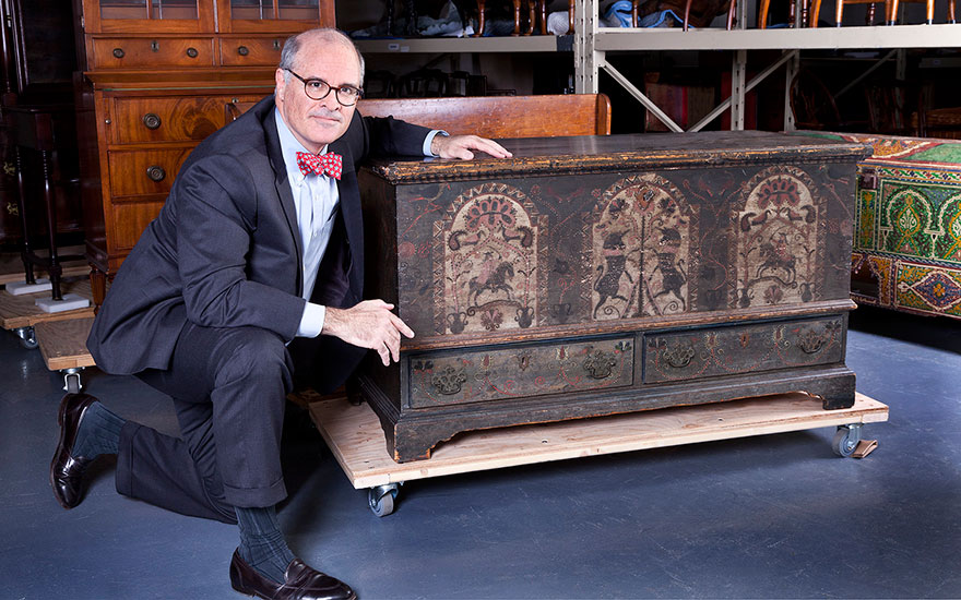 Christie's American Furniture specialist John Hays with a Pennsylvania German unicorn-painted chest from The Collection of Peggy and David Rockefeller