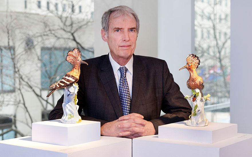 Rockefeller family historian Peter J. Johnson with a pair of Meissen porcelain hoopoes, modelled circa 1740 by J.J. Kändler