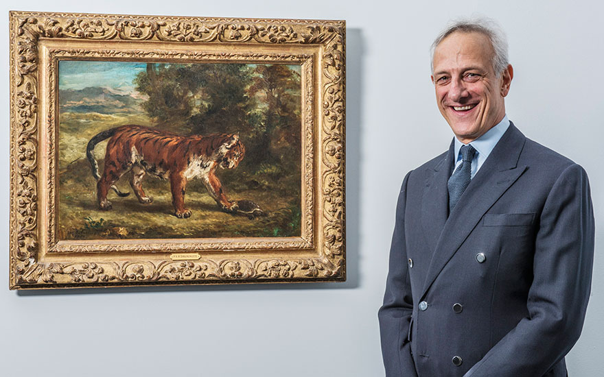 François de Ricqlès, President of Christie's France, with Eugène Delacroix's Tiger with Tortoise (1862) from The Collection of Peggy and David Rockefeller