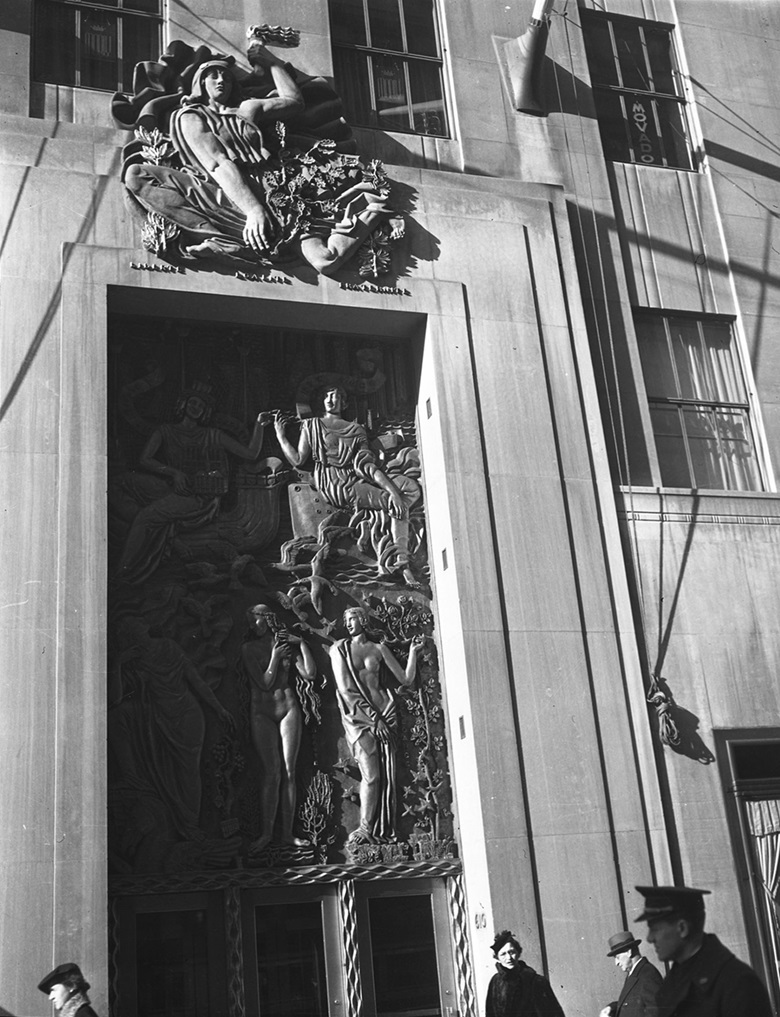 Alfred Janniot created the gilt relief above the entrance door of La Maison Francaise (main entrance of 610 Fifth Avenue). It is called Friendship Between America and France, 1934. Above Friendship Between America and France is Janniot's  Gallic Freedom. Photo William J. RoegeThe New York Historical SocietyGetty Images © ADAGP, Paris and DACS, London 2018
