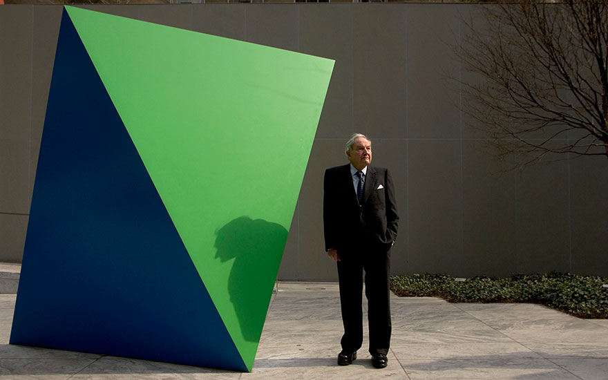 David Rockefeller in the Abby Aldrich Rockefeller Sculpture Garden at MoMA with Ellsworth Kelly, Green Blue, 1968. Painted aluminium, 262.7 x 285.5 x 173.7 cm. Photo Les StonePolariseyevine. Artwork