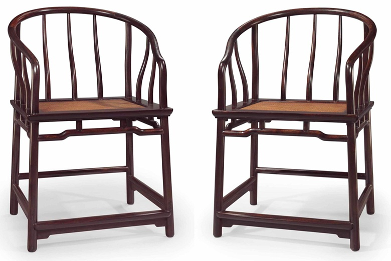 A very rare pair of zitan horseshoe-back armchairs, quanyi, 17th18th century. 36 116 in (91.7 cm) high; 25 in (63.5 cm) wide; 22¾ in (58.1 cm) deep. Sold for $1,085,000 on 20-21 March 2014  at Christie's in New York